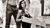 Models from Turkey posing on the graves of Greek Cypriots