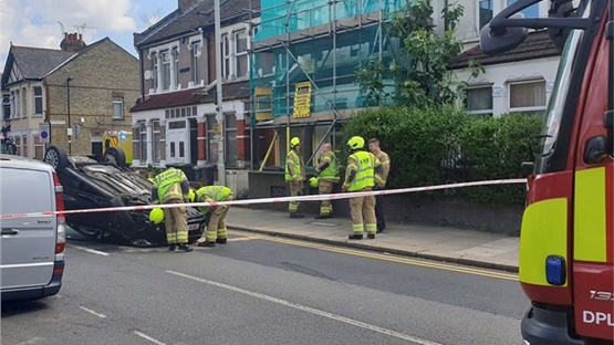 A car has flipped upside down at Westbury Avenue in north London