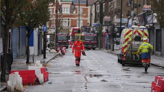 Two people died at the scene of an explosion and building collapse...