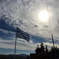 Η σημαία του καφεγλυκοπωλείου στον Άγιο Αντώνιο.